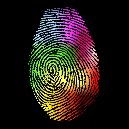 Rainbow colored fingerprint on black background