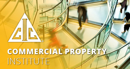 Commercial Property with CIC logo and image of indistinct people on glass spiral stairs